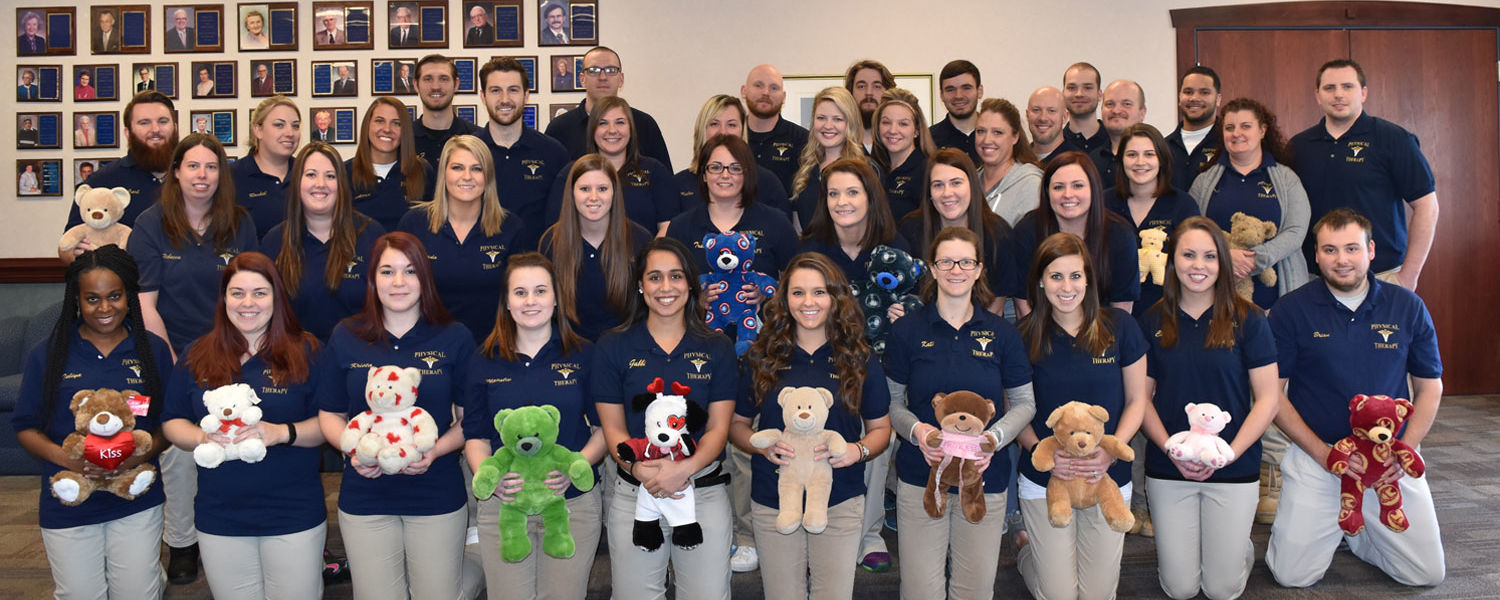 Students from the Kent State East Liverpool physical therapist assistant program hold stuffed bears in tribute to the young patients treated at St. Jude's Children's Research Hospital.
