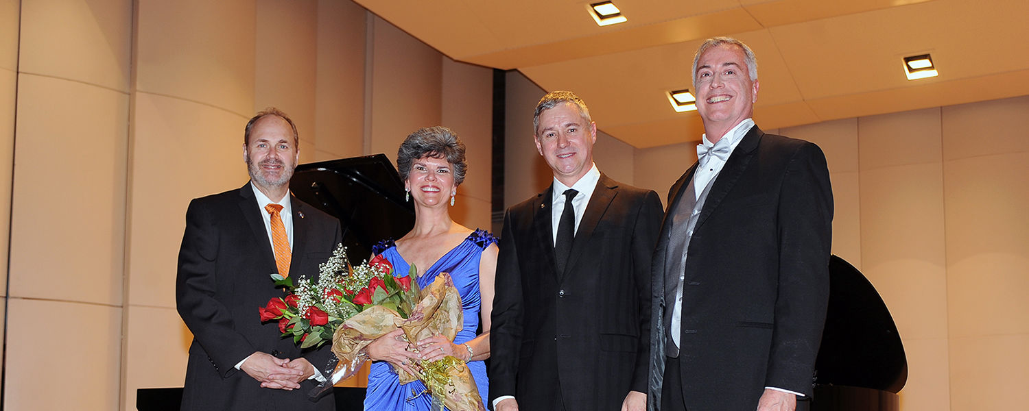 Kent State University Senior Vice President for Academic Affairs and Provost Todd Diacon, Kent State School of Music Director Denise Seachrist, Steinway and Sons President Ron Losby and Kent State College of the Arts Dean John R. Crawford pose for a pictu