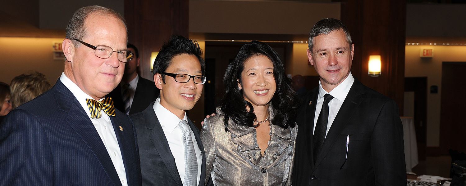 Steinway and Sons President Ron Losby (right), Kent State music professors Donna Lee and Jerry Wong, and Ted Good, president of Steinway Hall (left), during the reception for the All-Steinway designation, in Cartwright Hall.