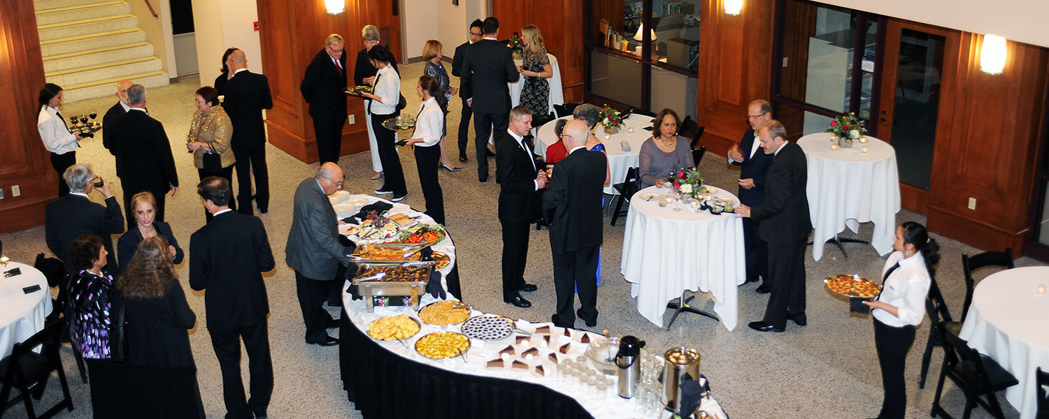 Guests enjoy the pre-event reception for the All-Steinway designation, in Cartwright Hall.