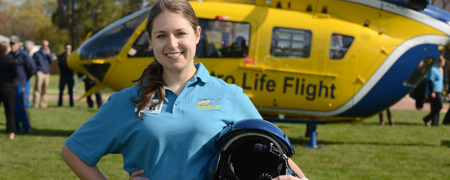 Kent State graduate nursing student Katherine Henkels poses in front of the Metro Life Flight helicopter.