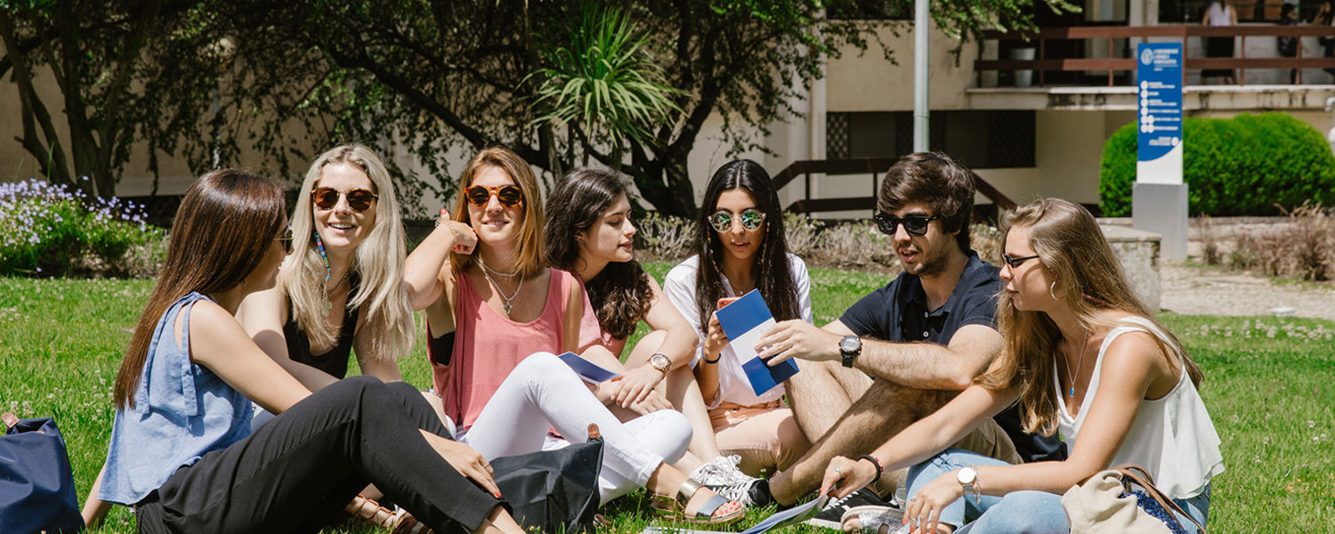 Students on the grass studying in Lisbon, Portugal