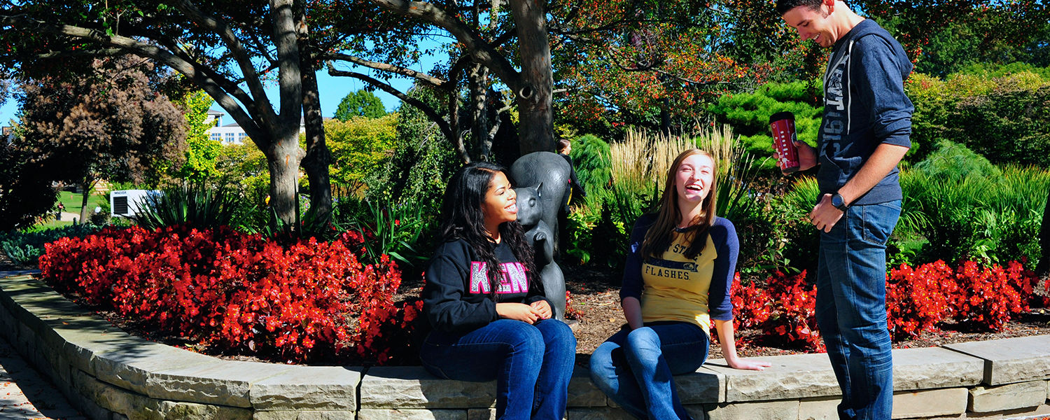 Kent State students share a laugh after meeting up near Risman Plaza. Students are encouraged to stop by Risman Plaza the first week of classes to meet new people, pick up Kent State gear and get food, while supplies last.
