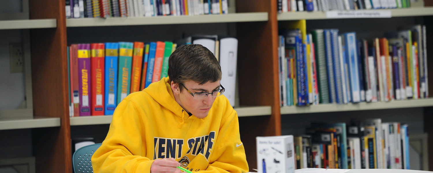 A Kent State student enjoys a peaceful space in the University Library to catch up on studying during finals week.