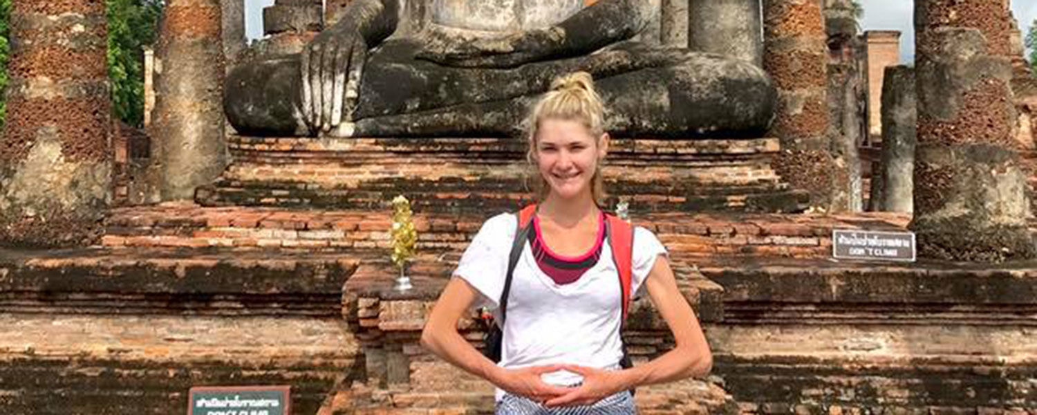 Woman standing in front of Suhkothai