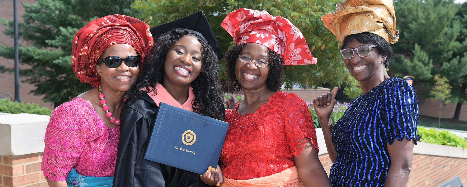 A Kent State graduate from Nigeria celebrates with family members outside the Memorial Athletic and Convocation Center (MAC Center) following the advanced degree ceremony for the Summer 2017 Commencement ceremony.