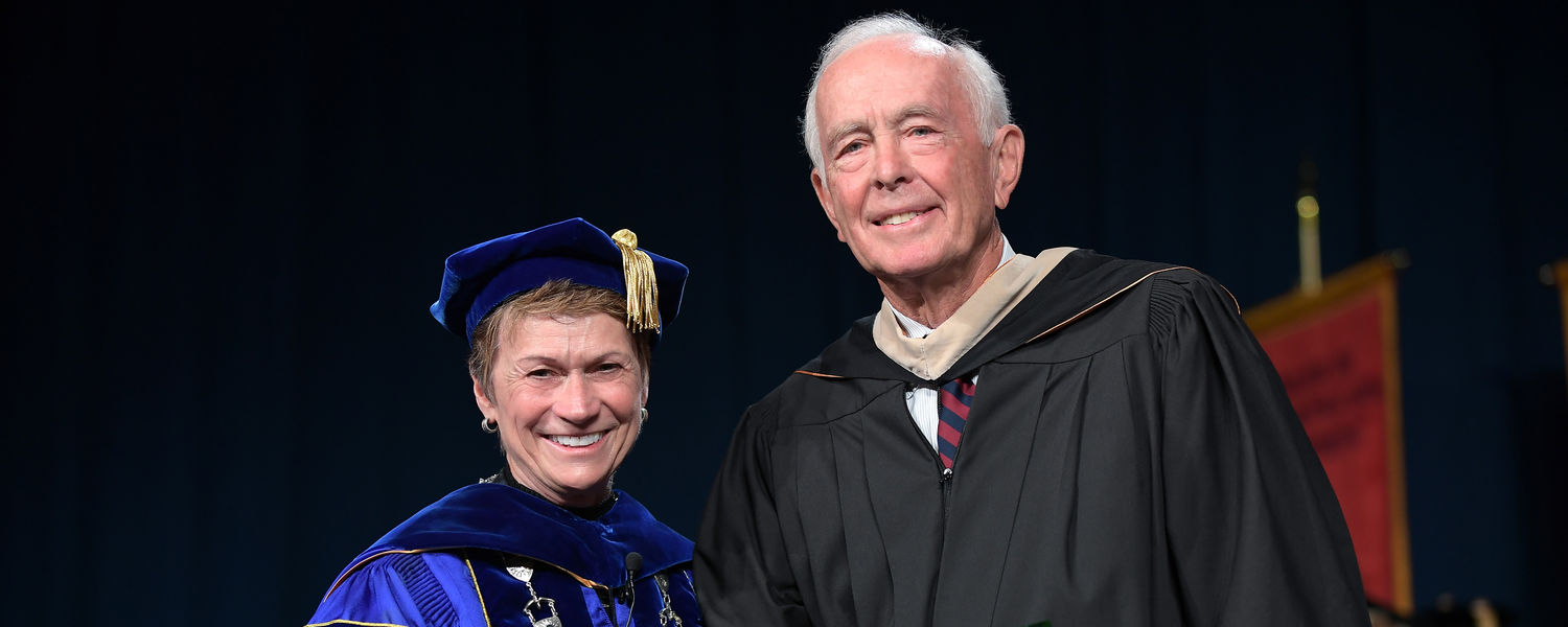President Beverly J. Warren presents Kent State alumnus and commencement speaker Robert M. Archer a Distinguished Alumni Award during Summer 2017 Commencement ceremonies.