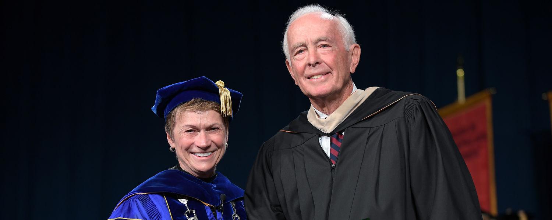 President Beverly J. Warren presents Kent State alumnus and commencement speaker Robert M. Archer a Distinguished Alumni Award during Summer 2017 Commencement ceremonies.