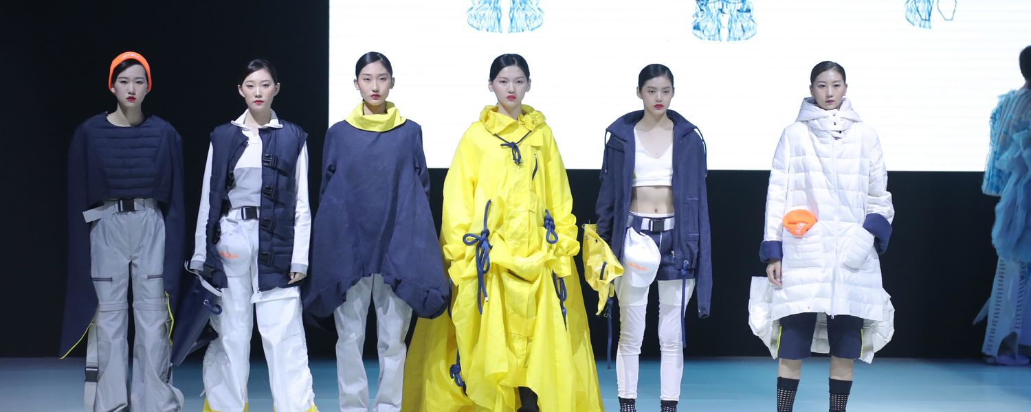 Models on the runway wearing Rojas designs at the IDYC in China