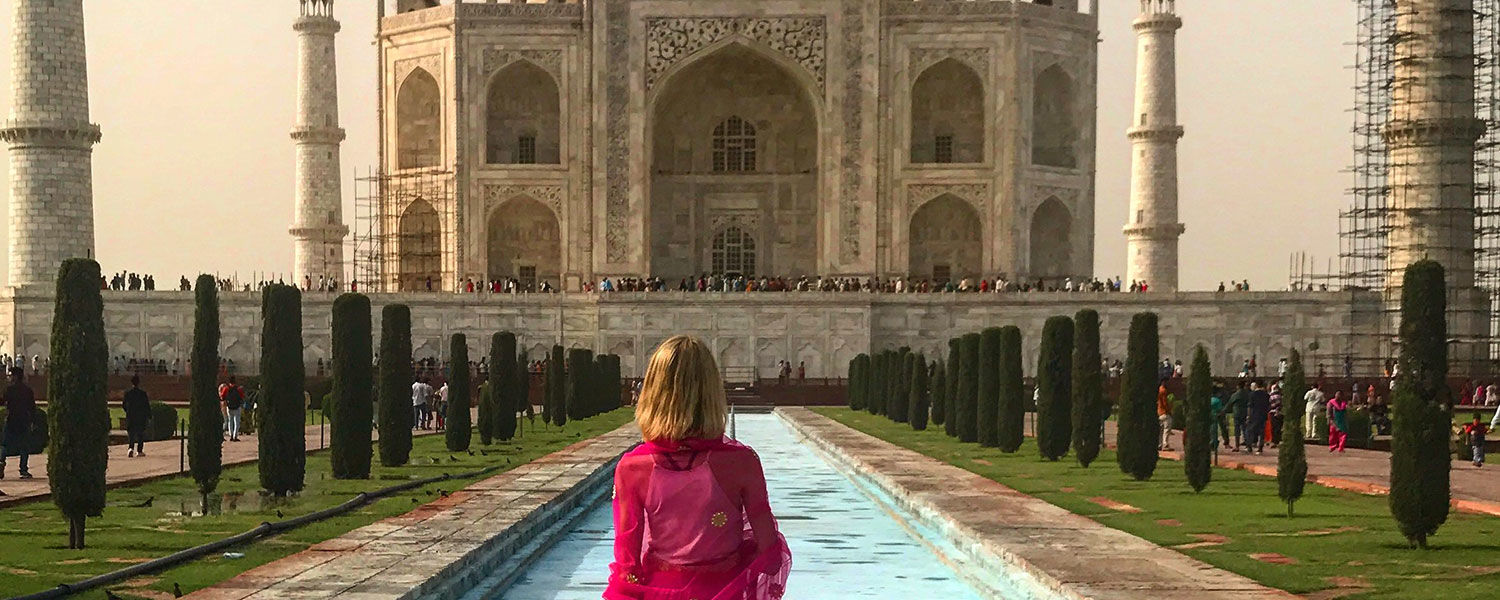 Woman standing in front of the Taj Mahal