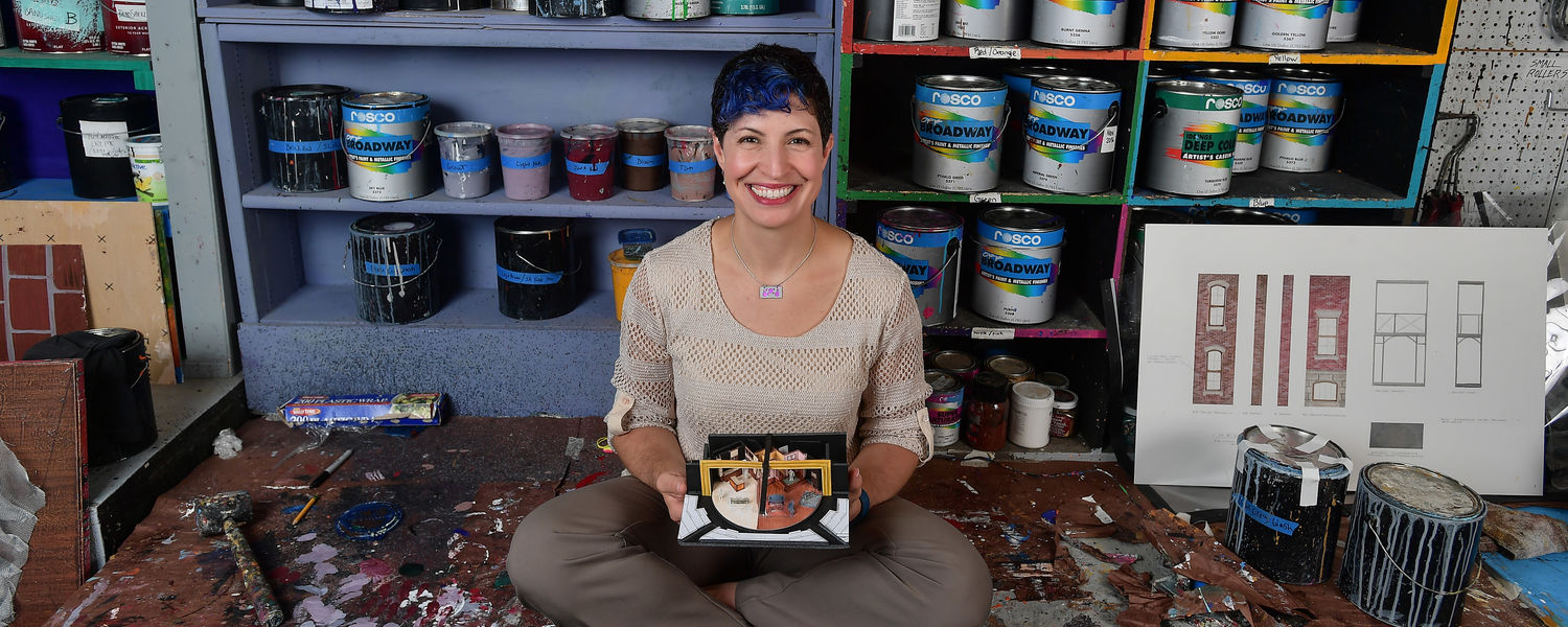 Tamara Honesty poses in the School of Theatre and Dance's Scene Shop