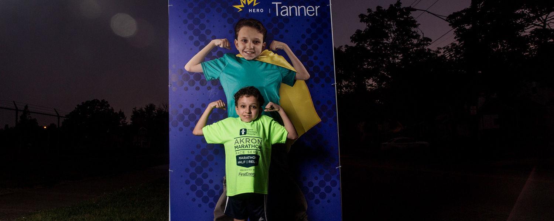 """""""Hero"""" poses at Akron Marathon"""
