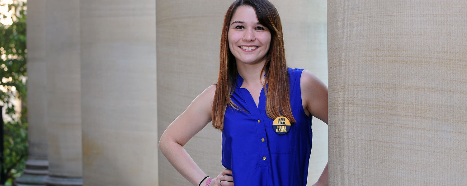 Kent State student Theresa Medrano stands near the pillars of Merrill Hall on campus.