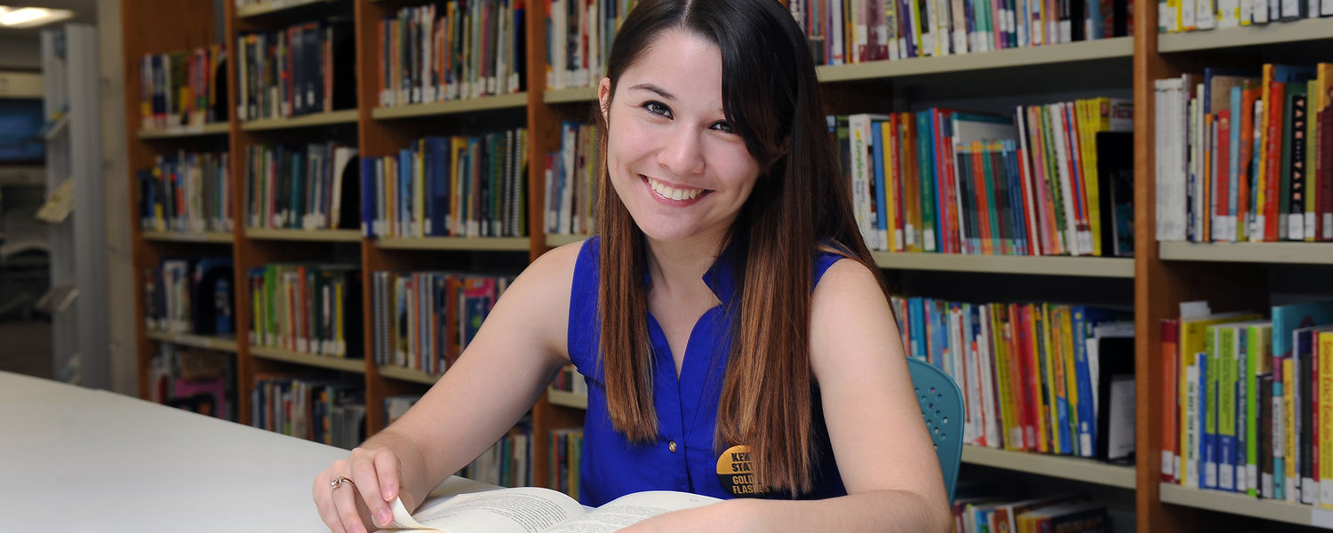 Kent State student Theresa Medrano spends time studying in a library in White Hall.