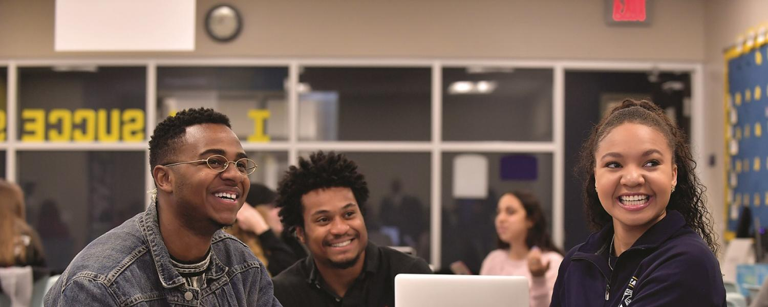 Three Kent State University students work together in a study group.