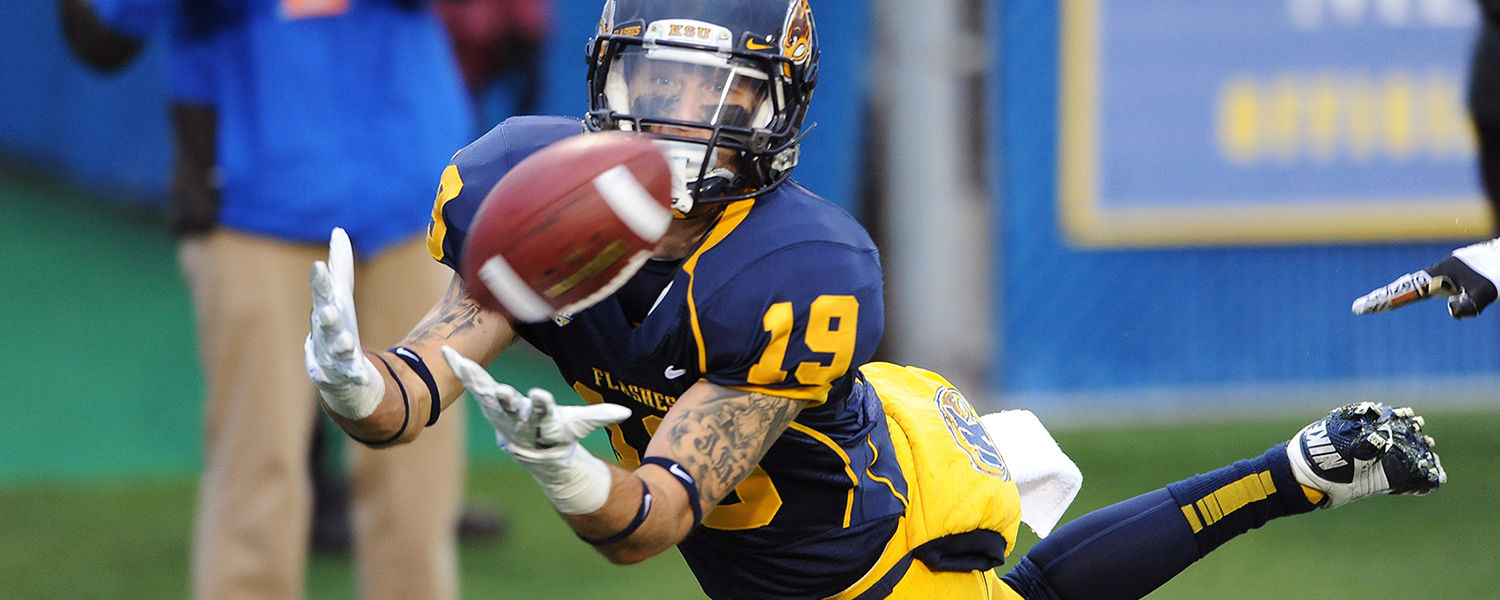 Kent State player Josh Boyle pulls in a touchdown pass during a home win last year at Dix Stadium.