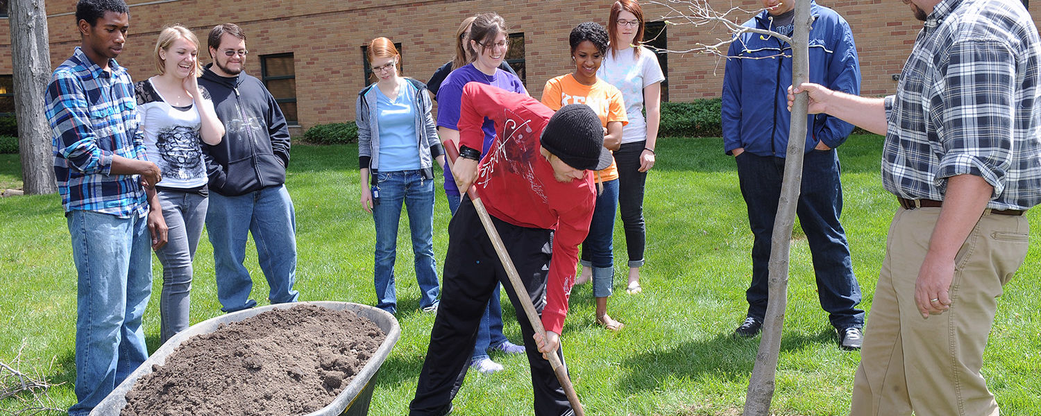 Kent State students volunteer to assist in a tree-planting ceremony by Engleman Hall during last year's Arbor Day celebration.
