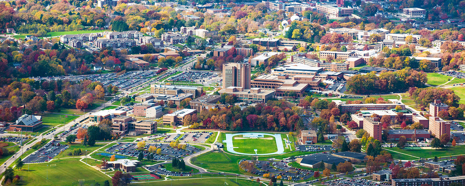 A colorful, fall aerial photo of the campus of Kent State, taken from a university aircraft, helps show why the university receives the Tree Campus USA recognition each year.