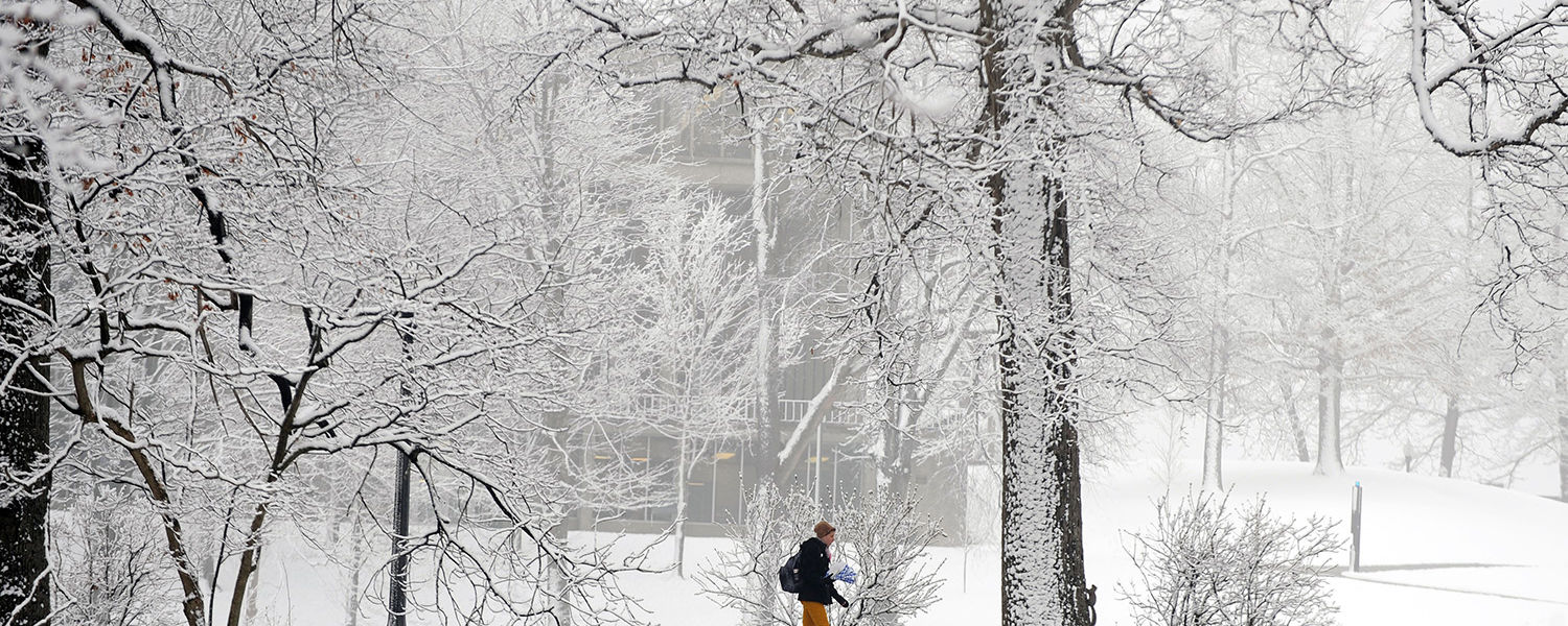 A Kent State student makes her way to class on a snowy winter morning near Ritchie Hall