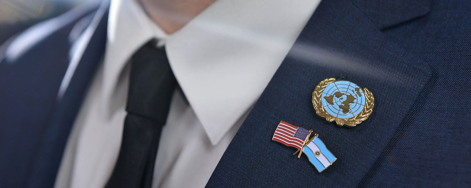 Pins featuring the flags of the United States, Argentina and the United Nations are fastened to Nahuel Gorostiza's lapel. The Kent State student is the U.N. Youth Delegate of Argentina.