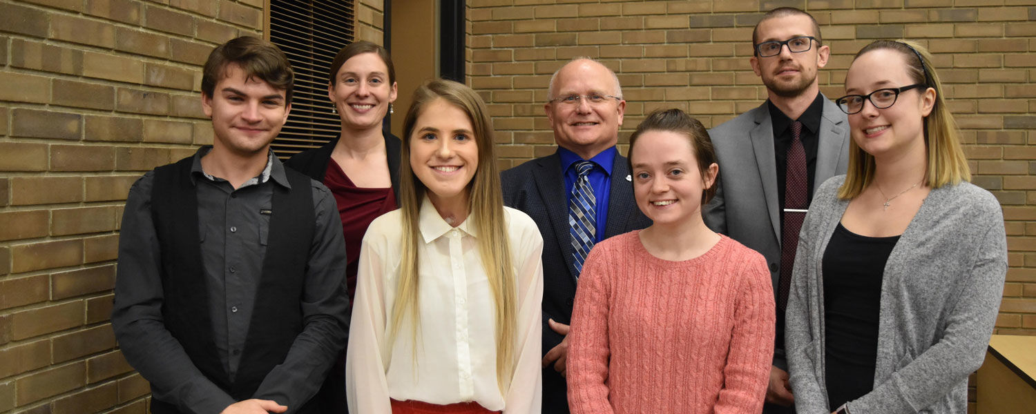 In the winners circle: (front, from left) Michael Laubacher, Sarah Miller, Stephanie Giles, Alicia Lamp; and (back, from left) Dr. Rachael Blasiman, chair; Dr. David Dees, dean; John Priddy