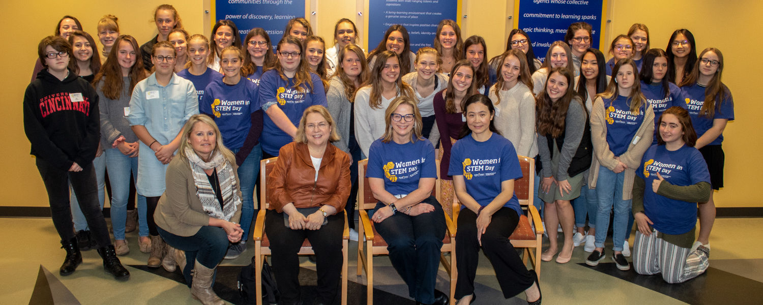 Students at Women in Stem event sitting for a group photo