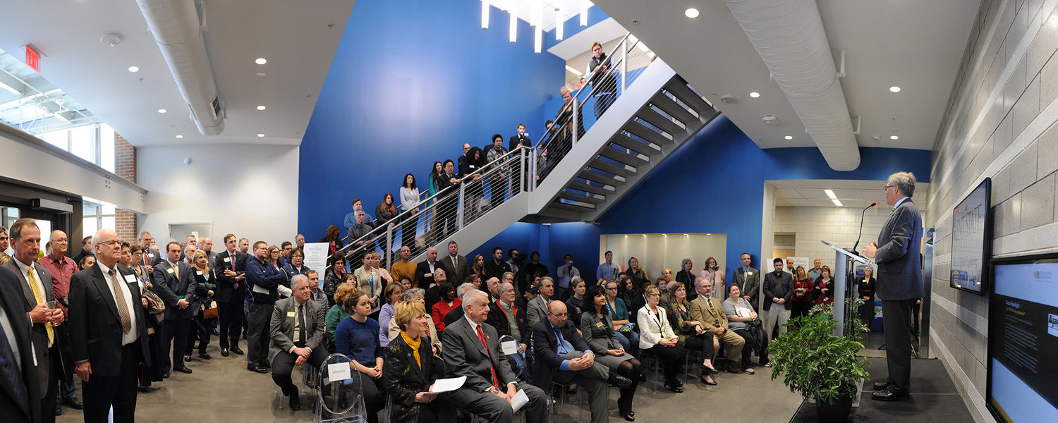 Dennis Eckart, Chair of the Kent State Board of Trustees, speaks during the April 24, 2015 grand opening of the Aeronautics and Technology Building.