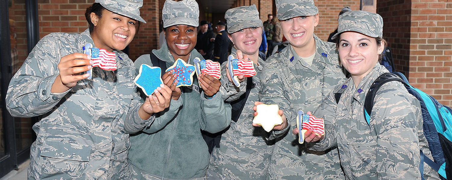 Kent State Army ROTC cadets display patriotic cookies they received at the informal reception in the Kent Student Center Kiva lobby following the 2015 Kent State Veterans Day observance.