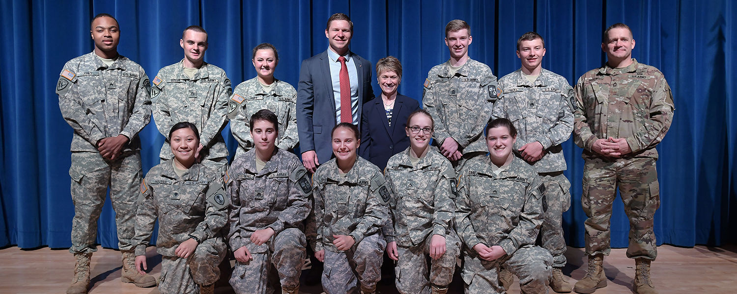 Veterans Day guest speaker Kevin Lacz and Kent State President Beverly Warren (center) pose with Kent State ROTC cadets and instructors following the university's annual Veterans Day observance at the Kent Student Center Kiva.