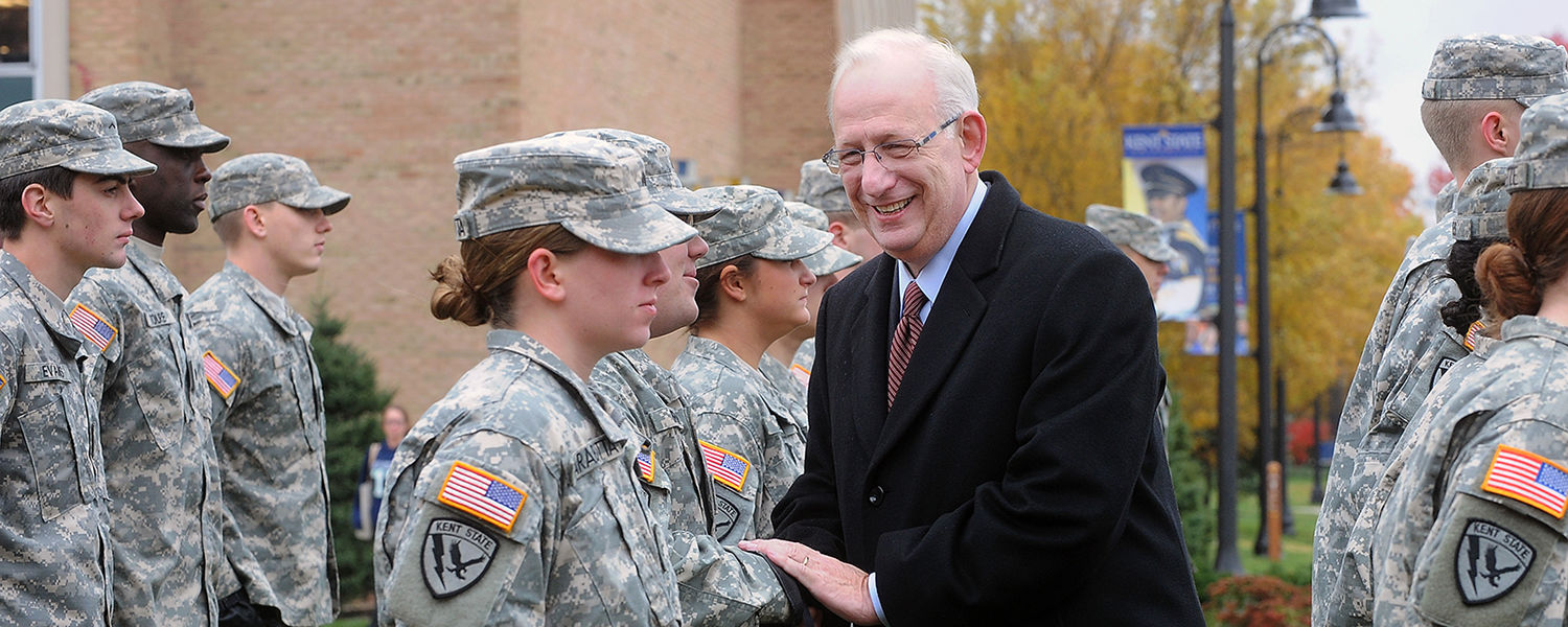 Kent State President Lester A. Lefton personally greets and thanks Kent State ROTC students during the university's annual Veterans Day observance on Risman Plaza.