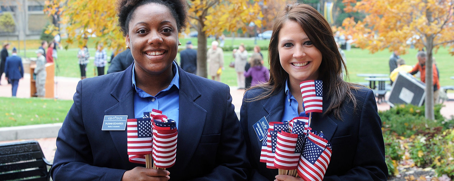 Kent State Student Ambassadors arrive early for the 2013 Veterans Day observance on Risman Plaza to distribute American flags.