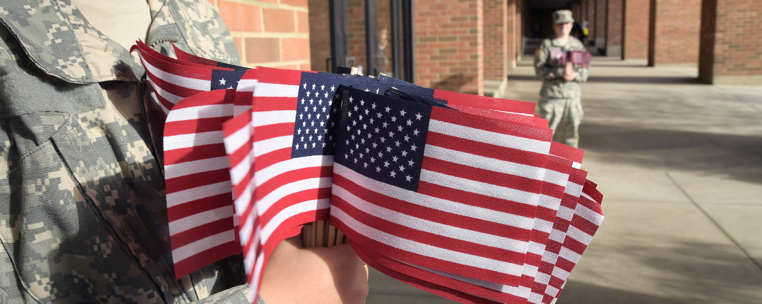 Kent State ROTC cadets distribute American flags as part of the university's annual Veterans Day observance, held this year at the Kent Student Center Kiva.