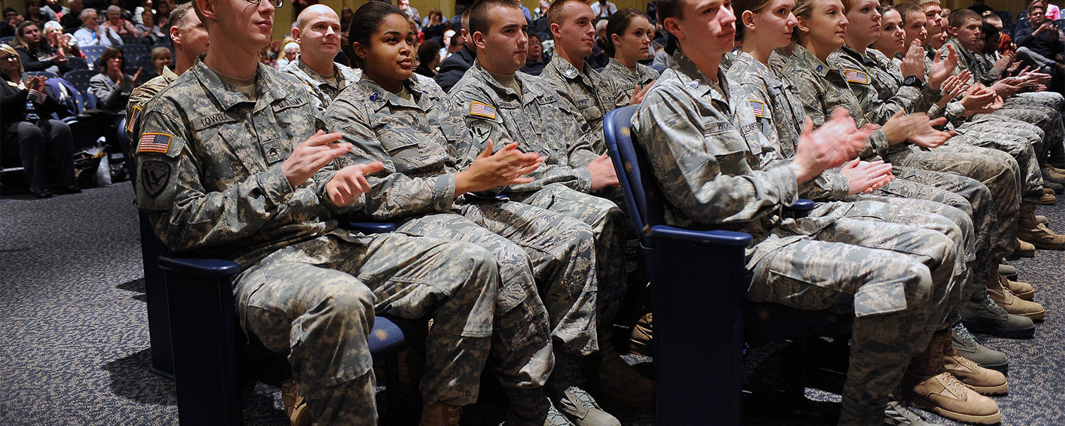 """Kent State ROTC cadets applaud during the address by guest speaker Richard """"Rex"""" Ray, a  '67 Kent State alumnus and retired U.S. Air Force colonel."""