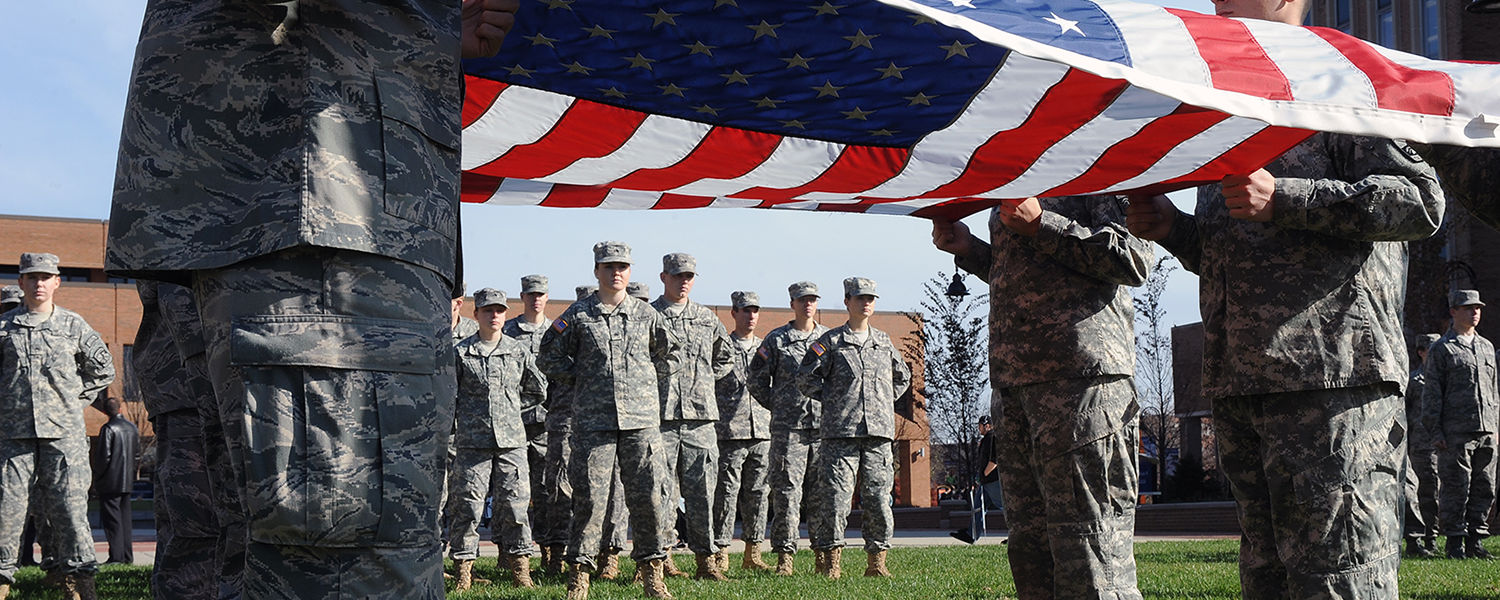 Members of the Kent State ROTC detachment stand at attention during the raising of the United States flag, over Risman Plaza.