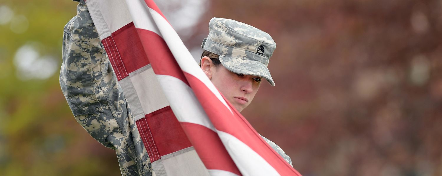 A Kent State ROTC cadet prepares to help raise the American flag at Risman Plaza as part of the university's annual Veterans Day observance.