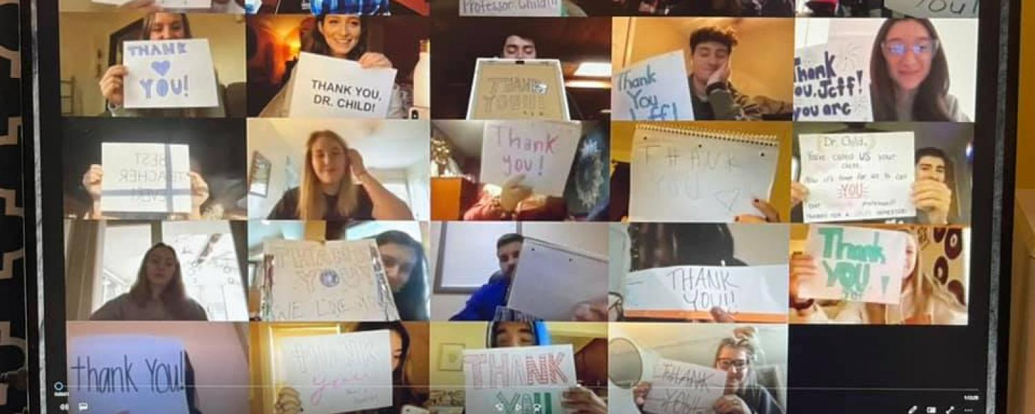 Students Thank Professor with Signs during a Zoom Call