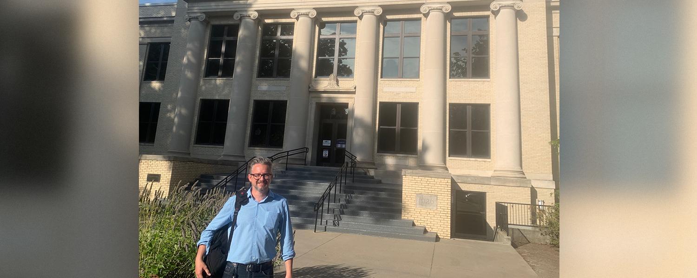 Visiting Humphrey Scholar Ruslanas Iržikevičius in front of Franklin Hall