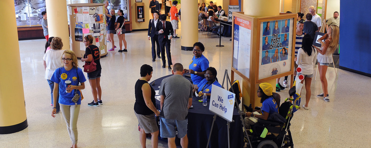 Incoming Kent State freshmen receive the latest information on Welcome Weekend events from staff in the lobby of the Kent Student Center.