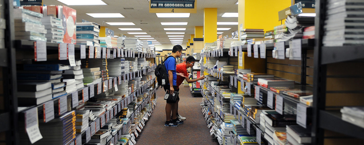 Students search for textbooks in the Kent State University Bookstore during the 2014 Welcome Weekend.