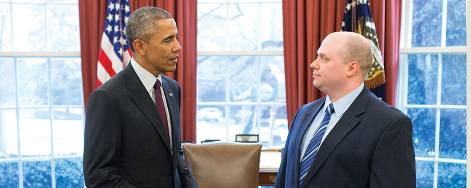 Image of WPNI Alum Douglas Graham '05 with President Barack Obama in the Oval Office.