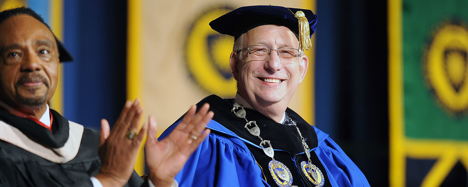Kent State President Lester A. Lefton enjoys an enthusiastic response from incoming   freshmen during Convocation.
