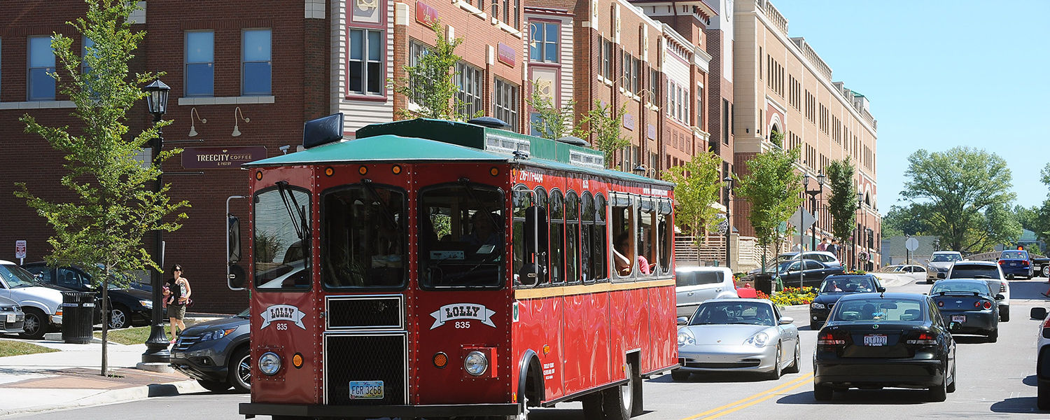 A trolley makes its way through downtown Kent, loaded with Kent State freshmen  who participated in Welcome Weekend and the Discover Downtown event.