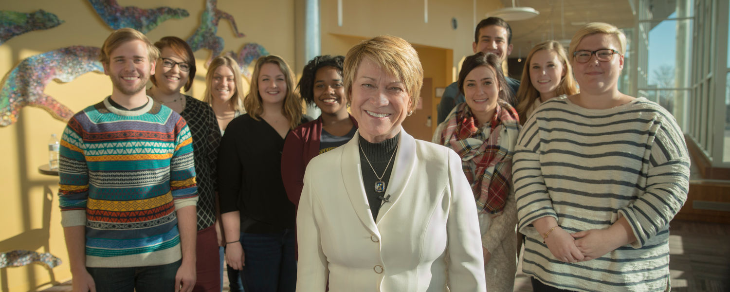 Kent State University President Beverly Warren, pictured here with Kent State students, has personally matched $25,000 for donations made to Kent State on Giving Tuesday.