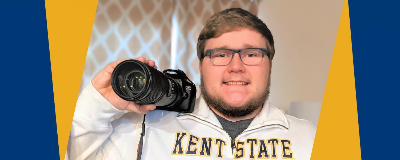 Kent State Tuscarawas student Jason Keller holding camera