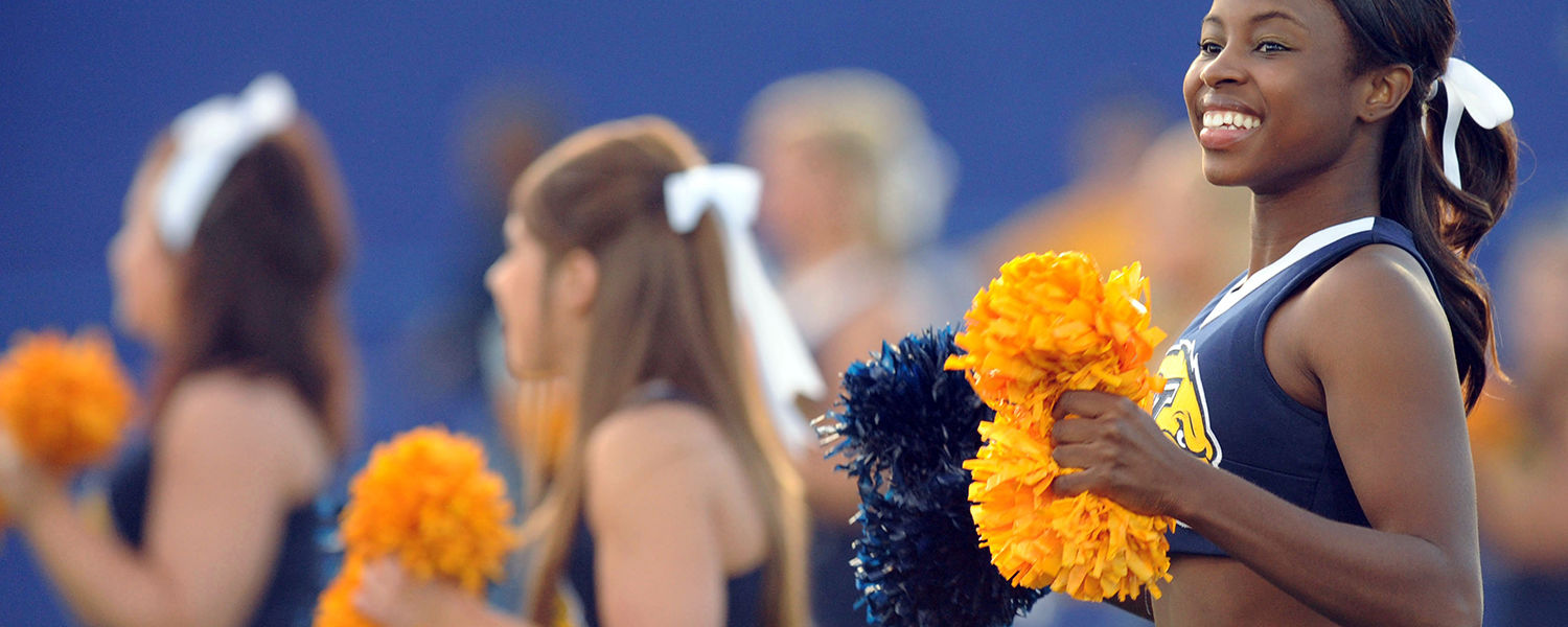 Cheerleaders lead and energize Kent State supporters at an event on campus.