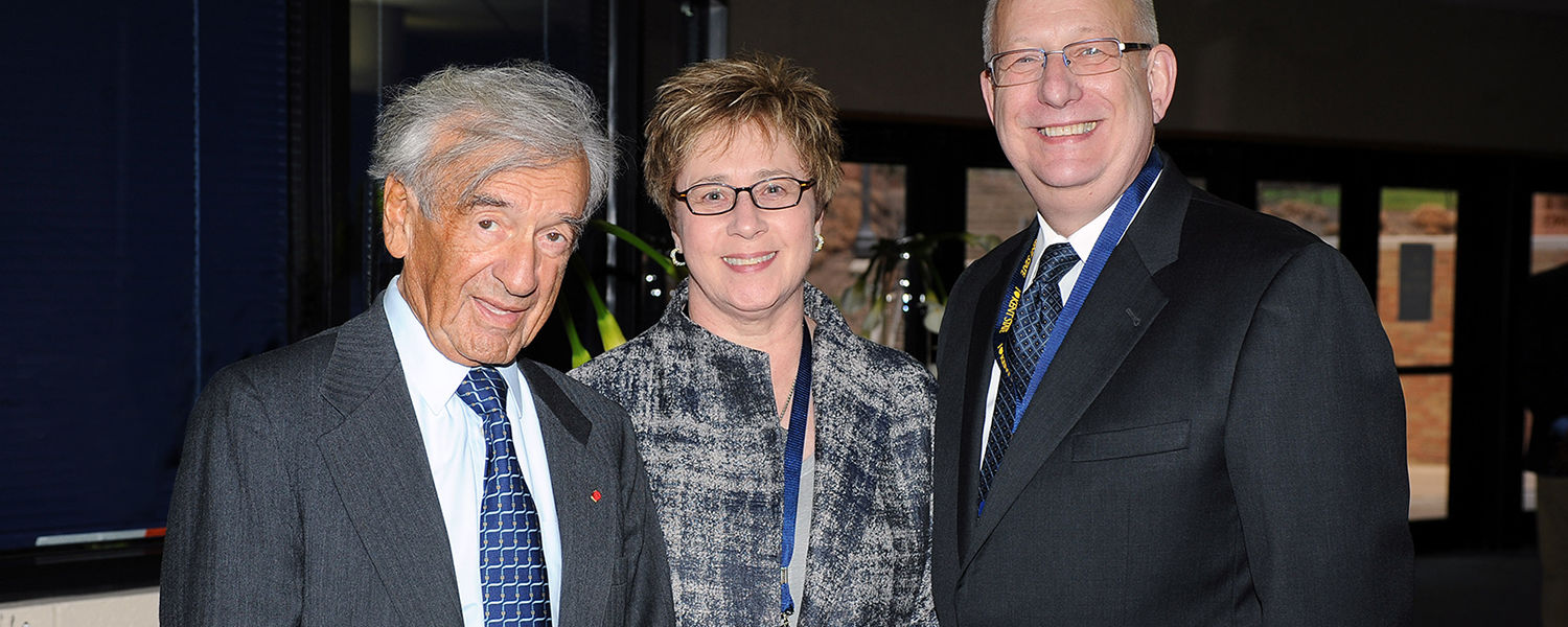 Kent State University President Lester A. Lefton and his wife, Linda, pose for a photo with Nobel Peace Prize winner and Boston University Professor Elie Wiesel during a reception in the Memorial Athletic and Convocation Center.