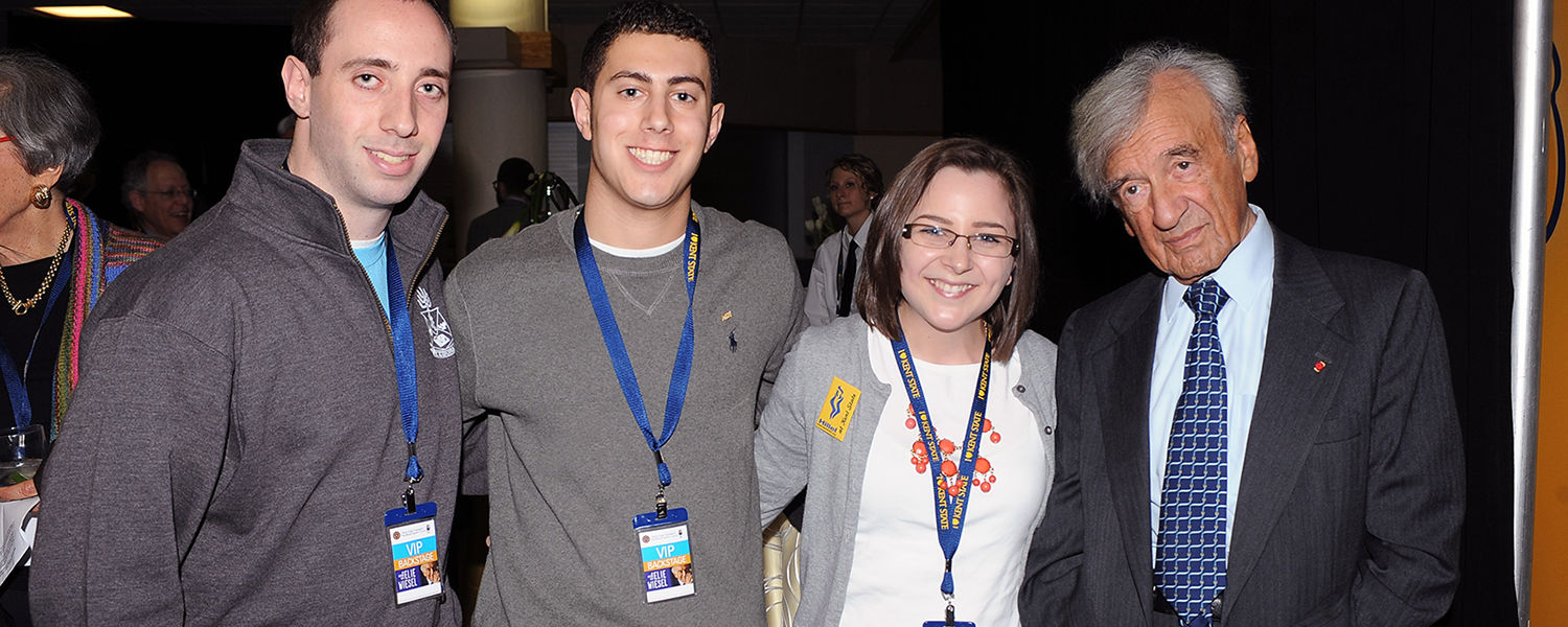 Elie Wiesel poses for a photo with Kent State students who attended the pre-event reception in the Memorial Athletic and Convocation Center.