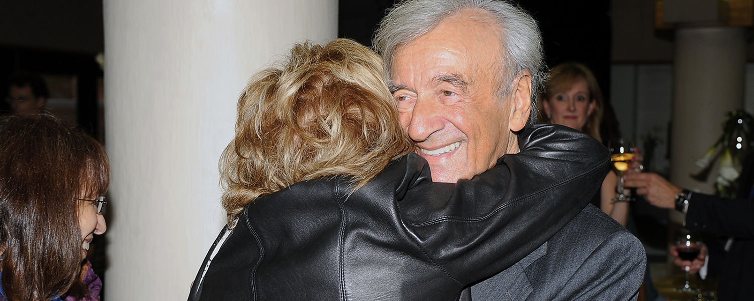 Elie Wiesel receives an emotional greeting from a friend during the pre-event reception in the Memorial Athletic and Convocation Center.