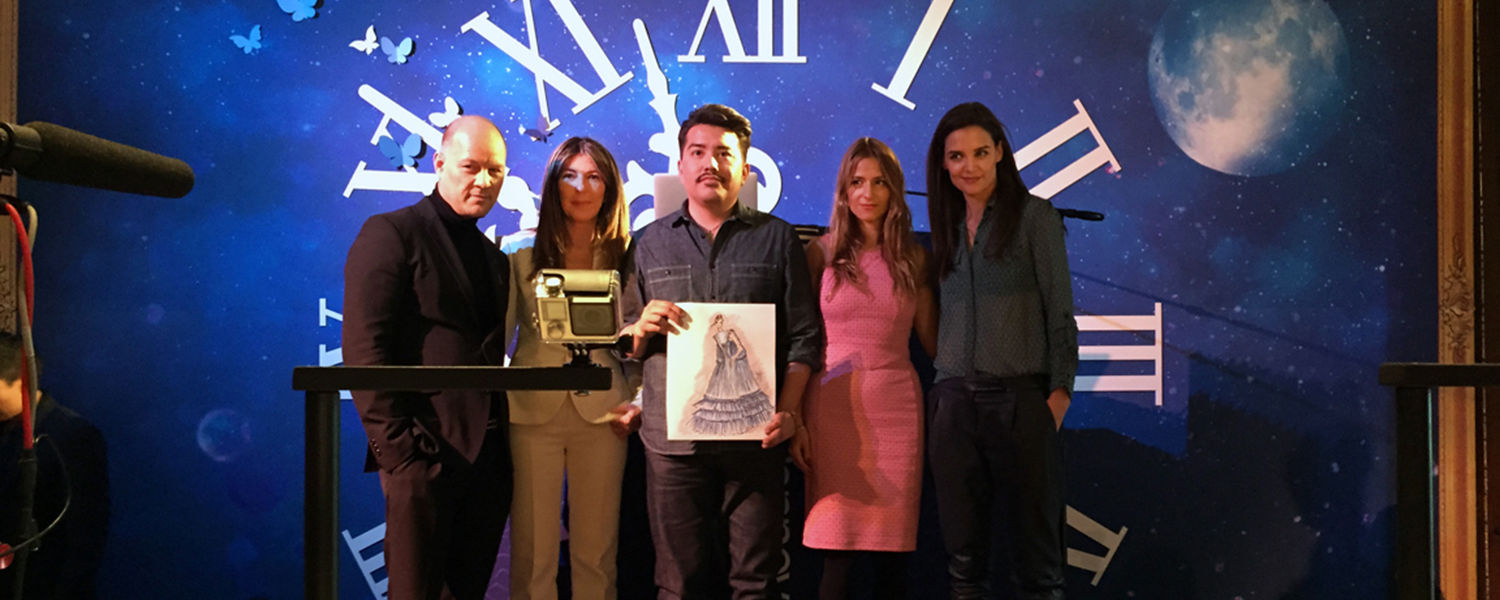 Jay Lewis (center), a Kent State senior, holds his winning design while standing with judges Geoffrey Henning, Nina García, Charlotte Ronson and Katie Holmes.
