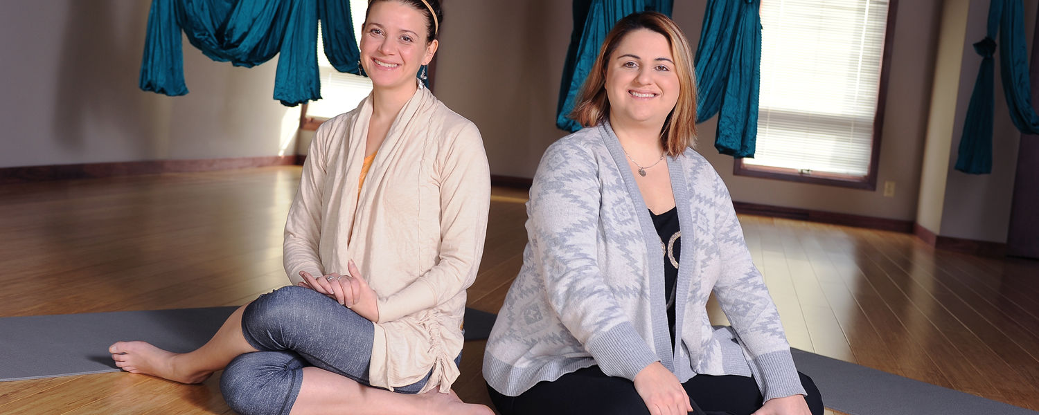 Co-owners Nichole Catalano-Miller (left) and Amanda Edwards (right) sit in their new Centerpiece Yoga and Wellness Center in Kent, Ohio. Catalano-Miller is a Kent State student majoring in exercise physiology.